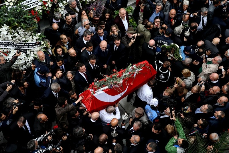 Turkish photographer Ara Güler's coffin is carried into the Üç Horon Armenian church during his funeral at Galatasaray Square on Istiklal avenue in Istanbul on October 20, 2018.