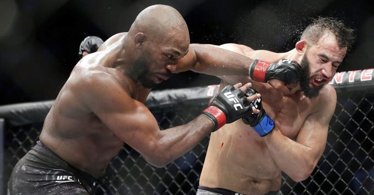 Jon Jones (L) connects a punch on Dominick Reyes during the bout at UFC 247, Feb. 9, 2020. (AP Photo)