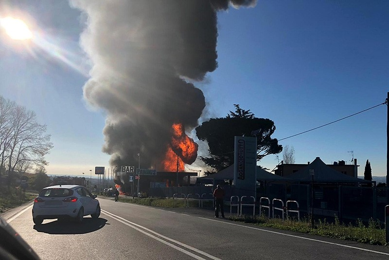A view of a column of smoke following an explosion that occurred at a petrol station in Borgo Quinzio, near Rieti, central Italy, Dec. 5, 2018.