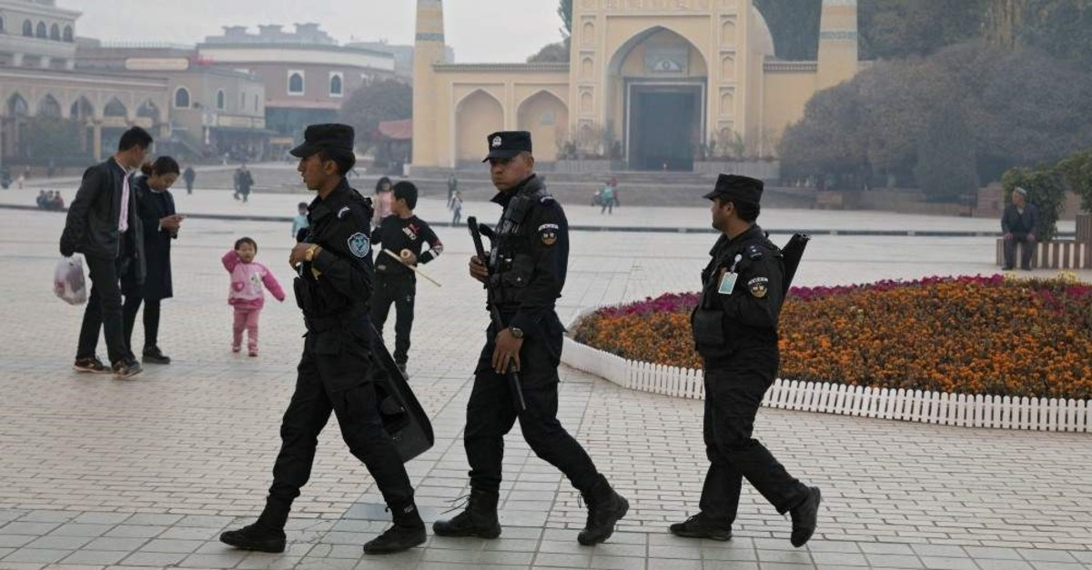 In this Nov. 4, 2017, file photo, Uighur security personnel patrol near the Id Kah Mosque in Kashgar in western China's Xinjiang region. (AP Photo)