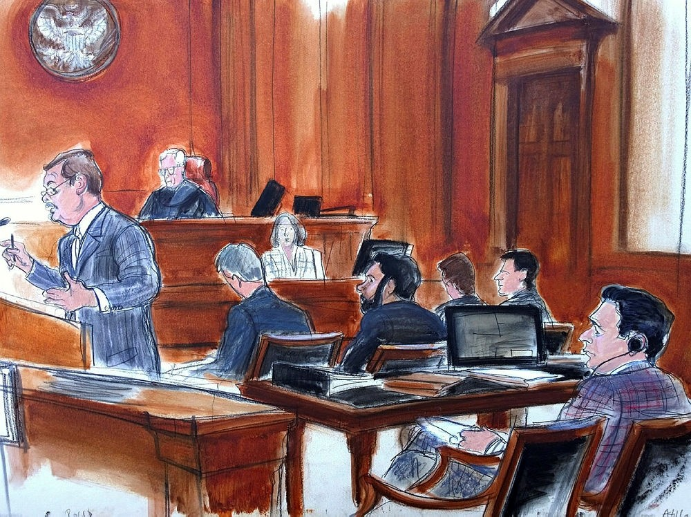 Courtroom sketch shows defense attorney Victor Rocco, left, gives his opening statement to the jury, as his client, Mehmet Hakan Atilla, right rear, listens from the defense table in New York.