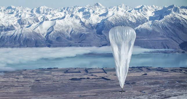 In this June 10, 2013 photo released by Jon Shenk, a Google balloon sails through the air with the Southern Alps mountains in the background, in Tekapo, New Zealand. (AP Photo)