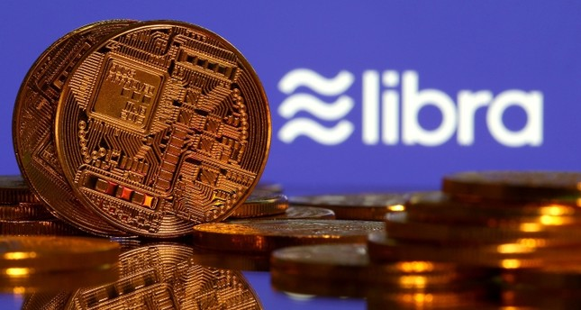 Representations of virtual currency are displayed in front of the Libra logo in this illustration picture, June 21, 2019. Reuters Photo