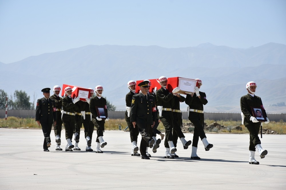 Soldiers carry the coffins of the mother and the baby killed by the PKK in a ceremony before they are sent to their hometown, northern Sivas province, for funeral service, yesterday.