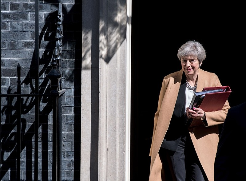 British Prime Minister Theresa May leaves 10 Downing Street in central London on April 19, 2017 ahead of the weekly Prime Minister's Questions session in the House of Commons. (AFP Photo)