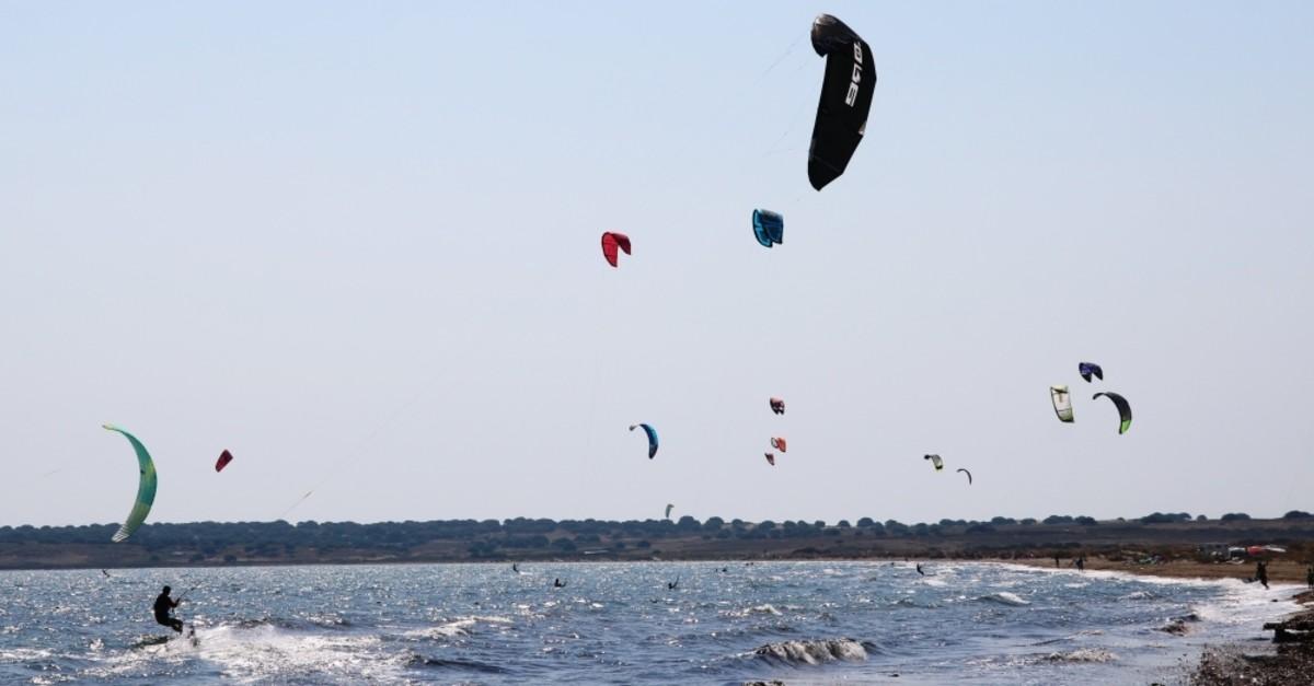 Wind and kitesurfers in Gu00f6ku00e7eada enjoy the waves.
