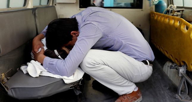 An Afghan man mourns over a dead body after a blast in a hospital in Kabul, Afghanistan August 15, 2018. (Reuters Photo)