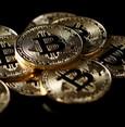 Bitcoin slides 18 percent, cryptocoins crash on crackdown fears