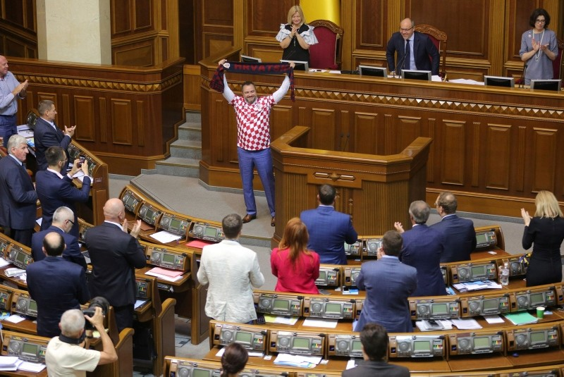 Ukraine football federation chief and lawmaker Andriy Pavelko, wearing a t-shirt of the Croatian football team, holds a scarf with the sign ,Croatia, during the parliament session in Kiev, Ukraine, July 10, 2018. (AFP Photo)