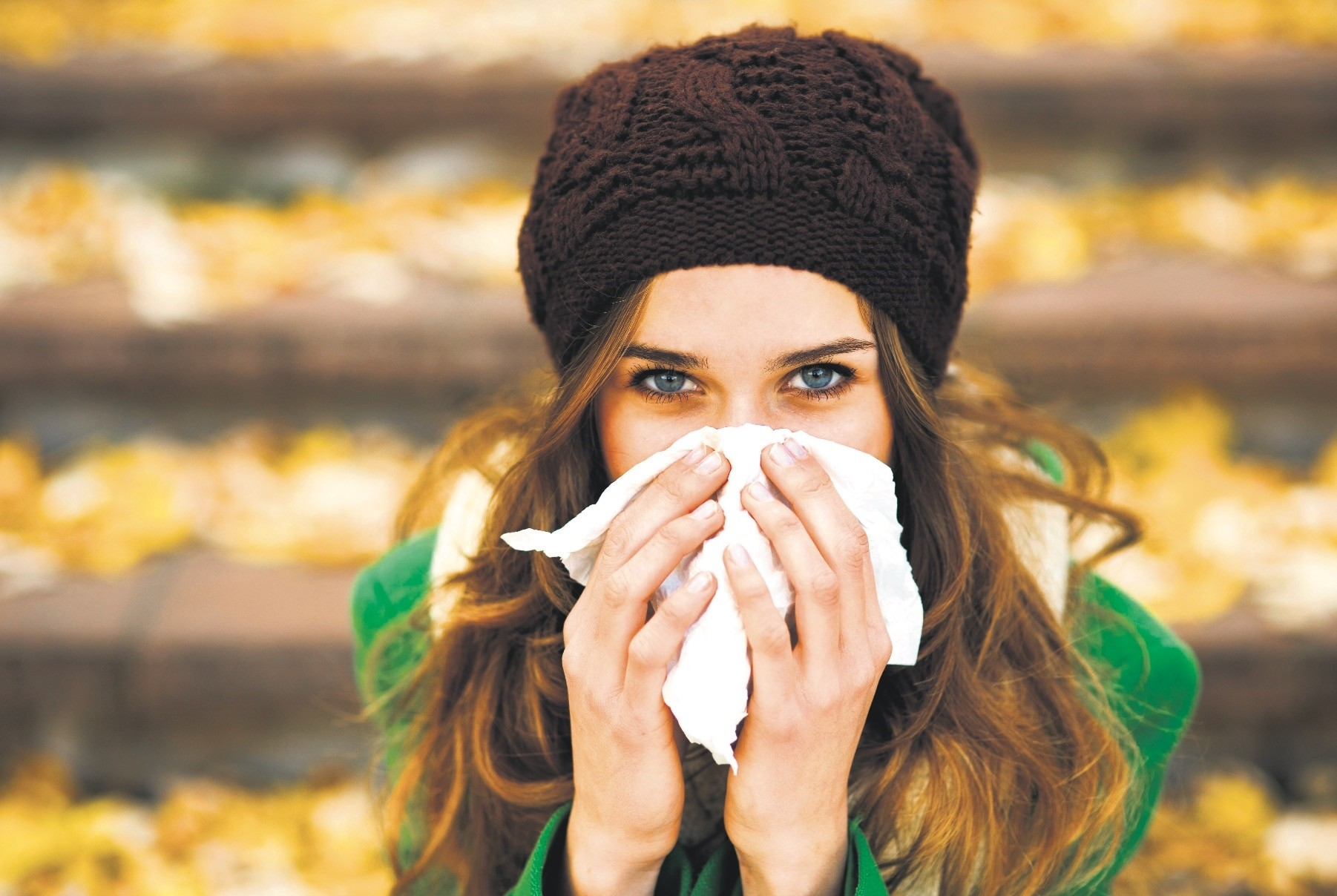 There is no relation between wearing a hat in the cold and protecting yourself from the cold. All you can do is boost your immune system.
