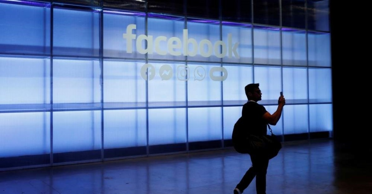 In this file photo, an attendee seen taking a photograph of a sign during Facebook Inc.'s F8 Developer Conference in San Jose, California, U.S., April 30, 2019. (Reuters Photo)