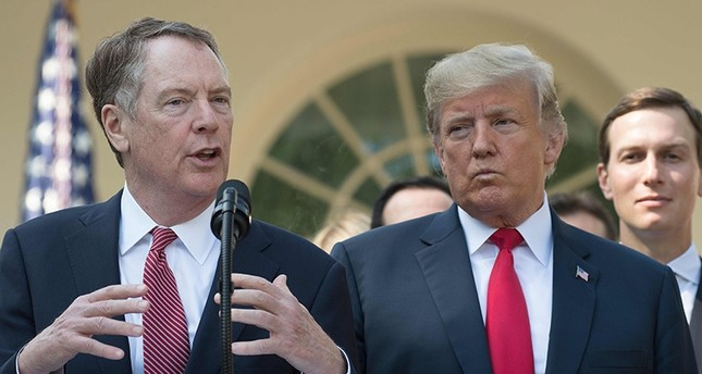 In this file photo taken on Oct. 1, 2018, U.S. Trade Rep. Robert Lighthizer speaks next to President Donald Trump. (AFP Photo)