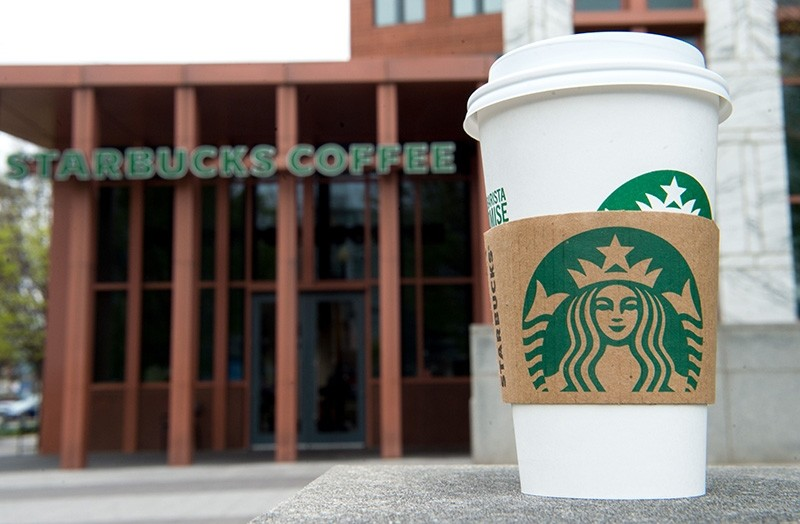In this file photo taken on April 17, 2018 a Starbucks coffee cup is seen outside a Starbucks Coffee shop in Washington, DC. (AFP Photo)