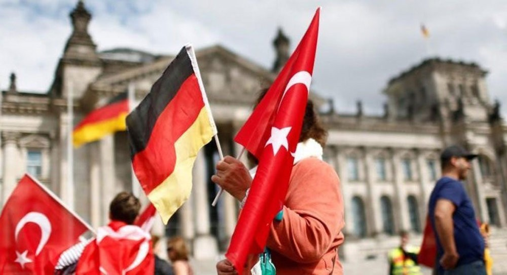 Demonstrator hold Turkish and German flags in front of the Reichstag, the seat of the lower house of parliament in Berlin while protesting against a vote in parliament that recognize the Armenian incidents as u201cgenocideu201d, June 1, 2016.