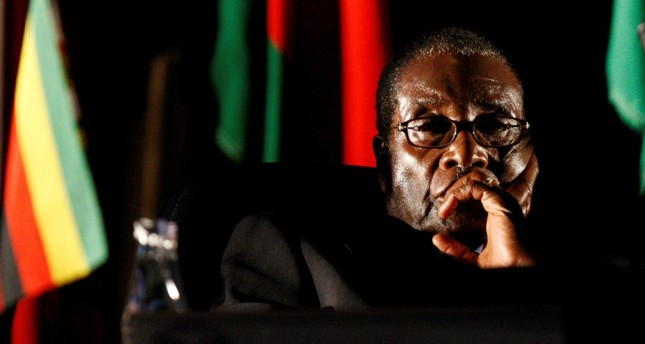 Zimbabwean President Robert Mugabe watches a video presentation during the summit of the Southern African Development Community (SADC) in Johannesburg, August 17, 2008. (Reuters Photo)