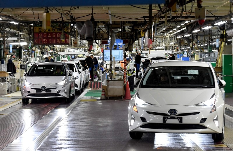 This Dec. 8, 2017 file photo shows fourth generation Toyota Prius cars being driven from the production line at the company's Tsutsumi assembly plant in Toyota City, Aichi prefecture, Japan. (AFP Photo)