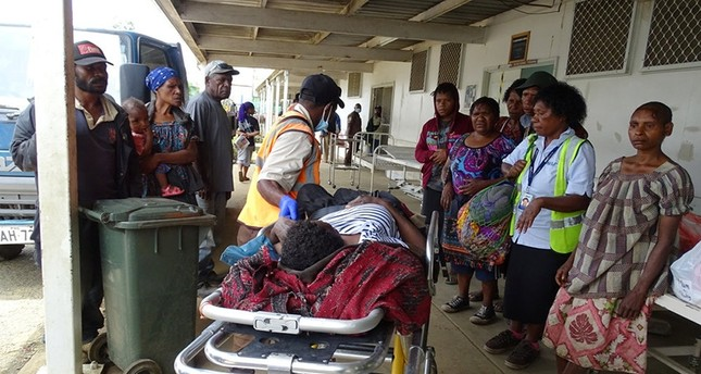 A resident receives medical treatment after an earthquake in Papua New Guinea in this handout image released March 7, 2018. (Reuters Photo)