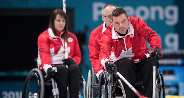Canada's Mark Ideson (R) attends a wheelchair curling practice ahead of the Pyeongchang 2018 Paralympic Winter Games at the Gangneung Curling Centre.