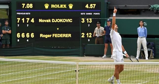 Serbia's Novak Djokovic celebrates winning the final against Switzerland's Roger Federer. (Reuters Photo)