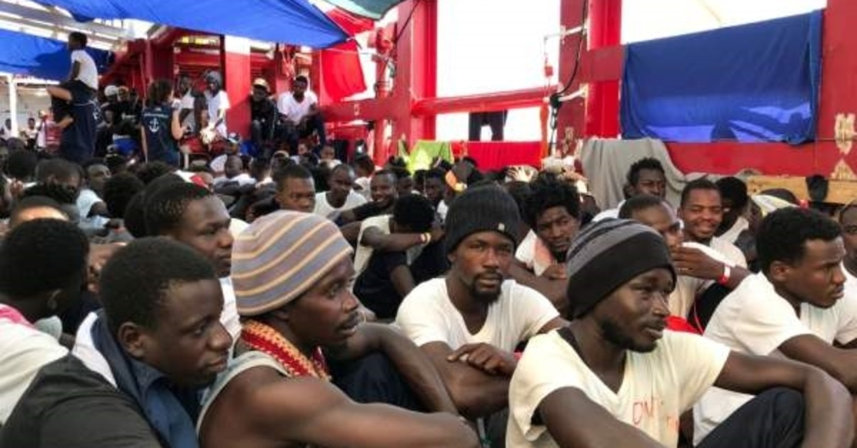 Rescued migrants gather aboard the Ocean Viking rescue ship at sea, Aug. 23, 2019. (AFP Photo)