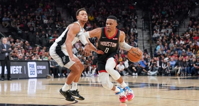 Rockets' Russell Westbrook drives past Spurs' Bryn Forbes in the second half of the match in San Antonio, Dec. 3, 2019. (Reuters Photo)