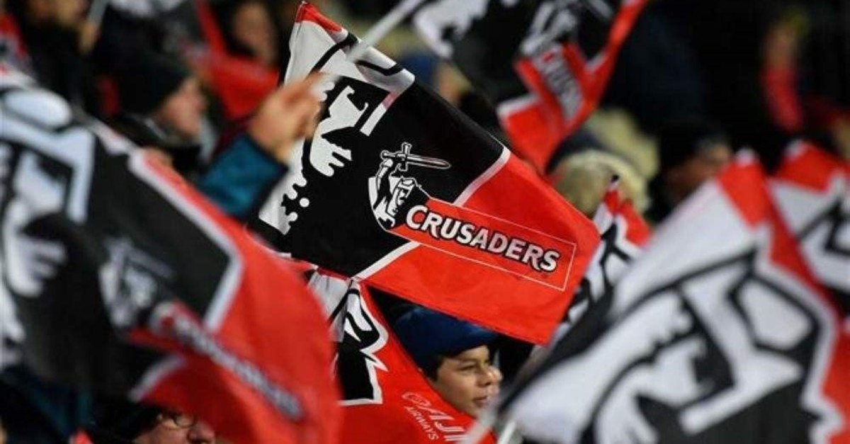 Crusaders fans celebrate during a match at their home stadium in Christchurch. (AFP Photo)