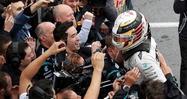 Mercedes driver Lewis Hamilton celebrates winning the race. (REUTERS Photo)