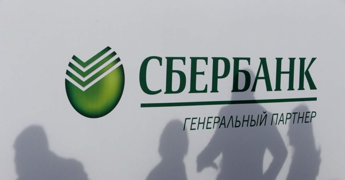 Participants cast their shadows on a board with the logo of Sberbank at the St. Petersburg International Economic Forum, Russia, June 1, 2017. (Reuters Photo)