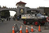 5 police, 1 inmate killed in Indonesia prison riot, police say