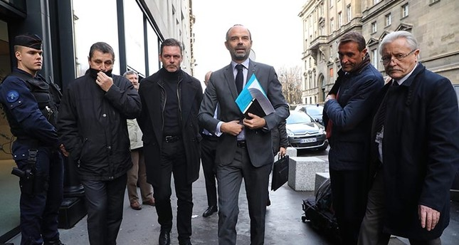 French Prime Minister Edouard Philippe arrives to announce the suspension on rising fuel taxes in Paris on Dec. 4, 2018. AFP Photo