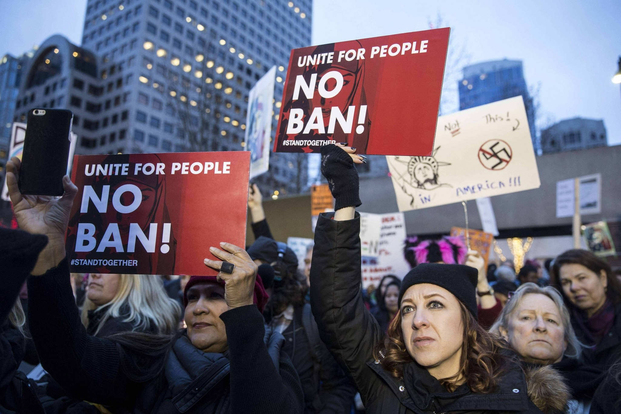 Protesters holding up signs in a demonstration against U.S. President Donald Trumpu2019s executive order banning Muslims from certain countries, Seattle, Jan. 29.