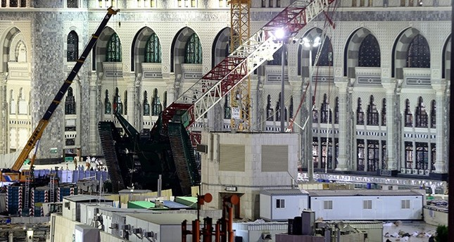 A towering construction crane, center, is seen collapsed over the Grand Mosque, in Mecca, Saudi Arabia, early Saturday morning, Sept. 12, 2015 (AP Photo)