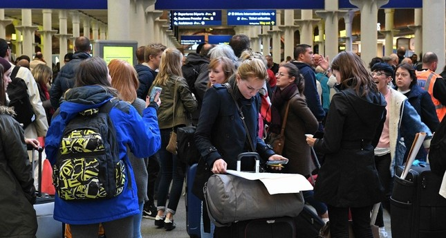 Passengers wait near the International departures area at the Eurostar terminal at the London St. Pancras train station, Oct. 18, 2019.