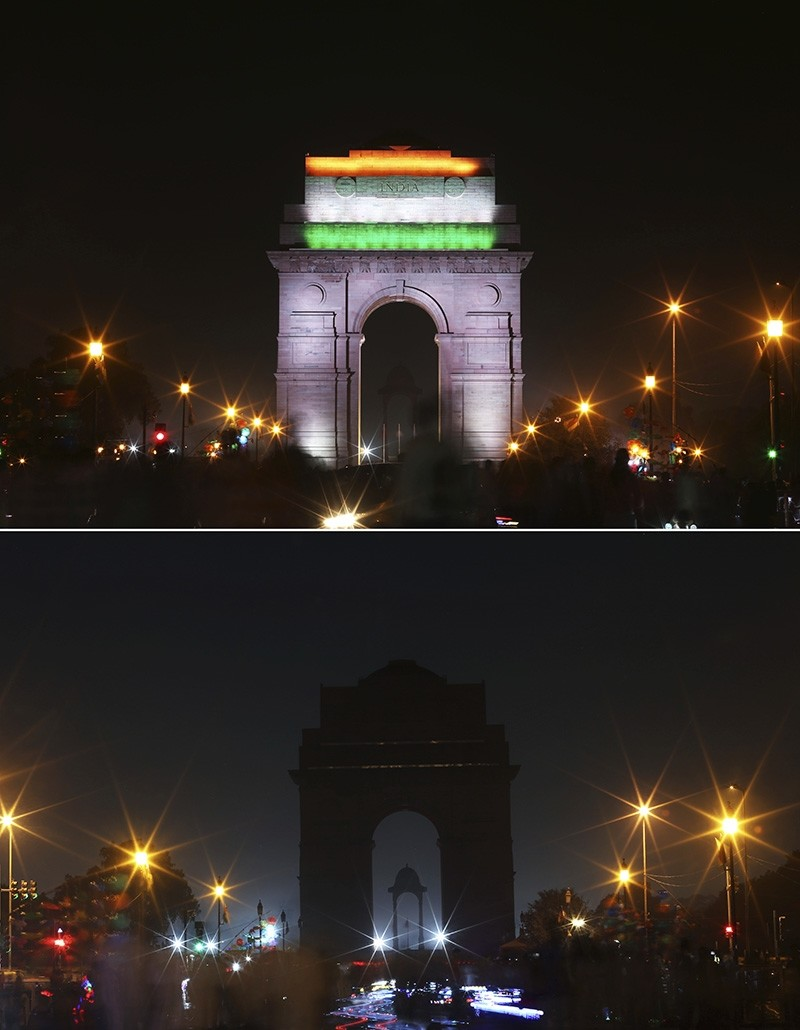 n this two photo combination picture, the landmark India Gate monument is seen lit, top, and then the same location in darkness when the lights are turned out for one hour to mark Earth Hour, in New Delhi, India, Saturday, March 24, 2018 (AP Photo)