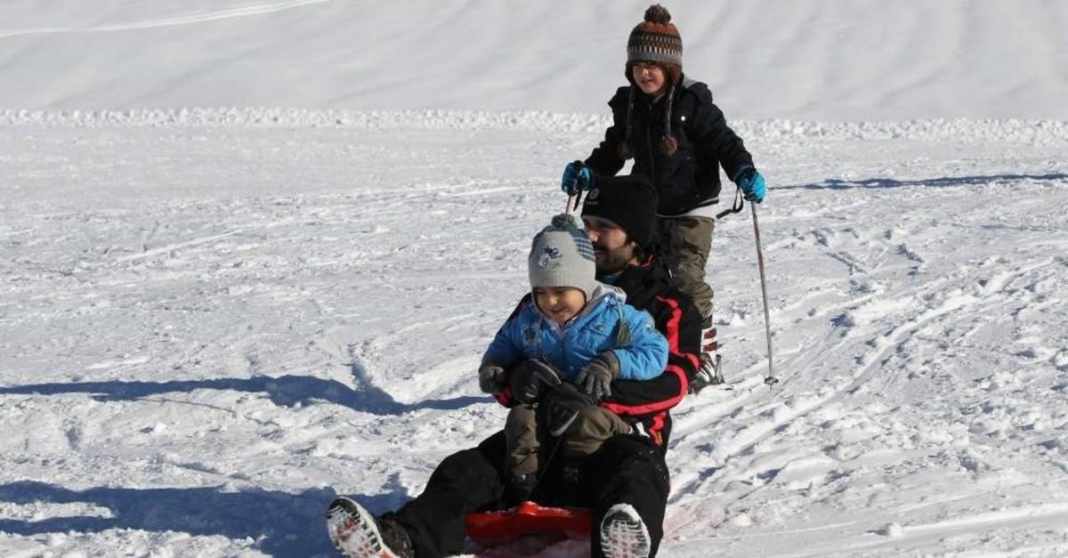 Children enjoy sliding at the new ski center in Hakkari. AA