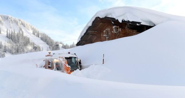 A snow blower is seen on the Loferer Alp in Lofer, Austrian province of Salzburg, Friday, Jan. 11, 2019. (AP Photo)