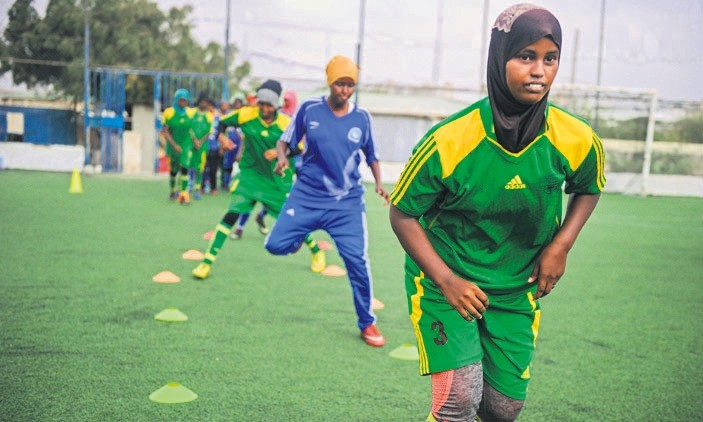 Somali football players of Golden Girls Football Centre, Somalia's first female soccer club, attend their training session at Toyo stadium.
