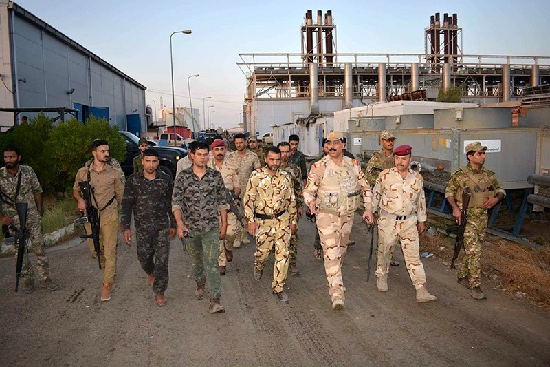 Iraqi security forces inspect the scene of suicide bomb attack at a power station in Samara city, 120 km northern Baghdad, Iraq on 02 September 2017. (EPA Photo)
