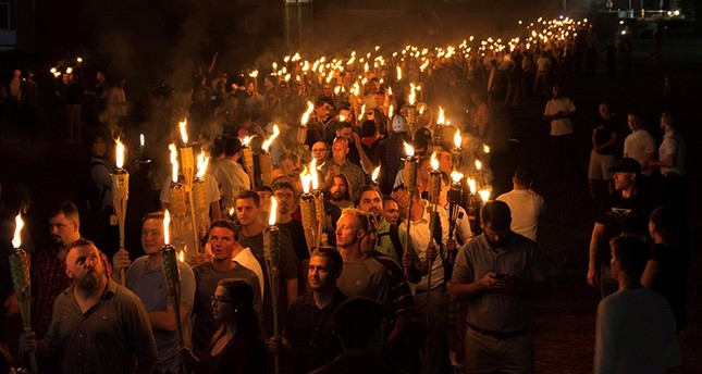 White nationalists carry torches on the grounds of the University of Virginia, on the eve of a planned Unite The Right rally in Charlottesville, Virginia, U.S. Aug. 11, 2017. (Reuters Photo)