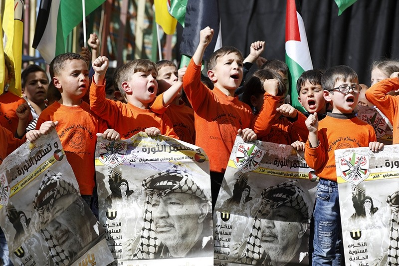 Palestinian children hold placards with a portrait of former Palestinian Liberation Organization (PLO), Fatah leader and Palestinian President Yasser Arafat at rally on Nov. 12, 2017. (EPA Photo)