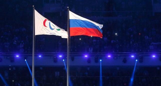 The Paralympic and Russian flags fly side by side at the Sochi Winter Olympics opening ceremony. (REUTERS Photo)