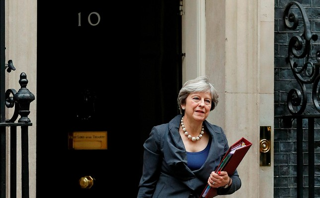 Britain's Prime Minister Theresa May leaves 10 Downing Street in central London on October 11, 2017, on her way to the Houses of Parliament to speak at Prime Minister's Questions PMQs. AFP Photo