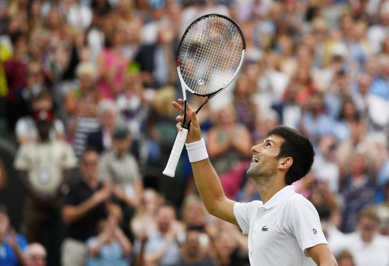 Novak Djokovic of Serbia reacts after beating Rafael Nadal of Spain in their semi final match during the Wimbledon Championships at the All England Lawn Tennis Club, in London July 14, 2018. (EPA Photo)