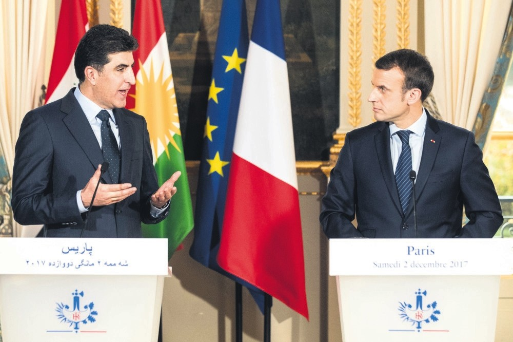 KRG Prime Minister Nechirvan Barzani and French President Emmanuel Macron (R) attend a press conference following their meeting at the Elysee Palace, Paris, Dec. 2.