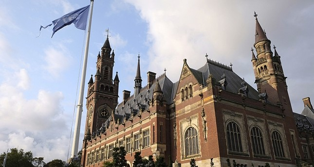 A United Nations flag flutters in the wind next to the International Court of Justice in the Hague, the Netherlands, Monday Aug. 27, 2018. (AP Photo)