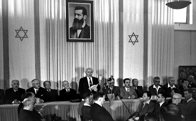 David Ben Gurion (C), Israel's first prime minister, declares independence for the State of Israel on May 15, 1948, which was made possible by a U.N. vote to partition Palestine, Nov.29, 1947.