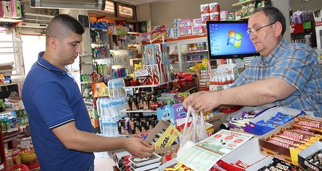 A customer shops at a local grocery store in Turkey's Western Edirne province (IHA Photo)