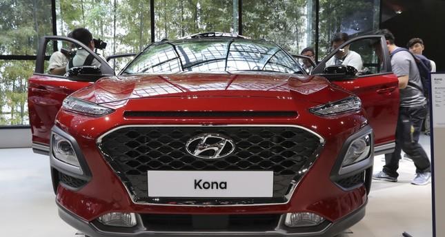 Media members and visitors surround Hyundai Motor's new Kona SUV in Goyang, South Korea.