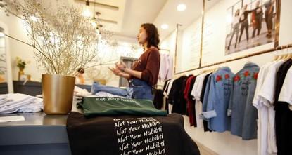Palestinian designer seeks to empower women with slogan T-shirts