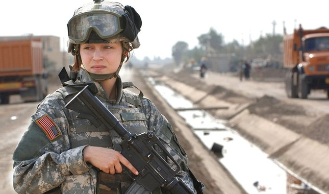 U.S. Army Pfc. Janelle Zalkovsky provides security while other soldiers survey a newly constructed road in Ibriam Jaffes, Iraq, Dec. 4, 2005. (U.S. Army photo)
